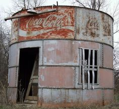 """""""Abandoned Oklahoma Oil Tank Soda Stand"""" -- [This round coca-cola building is located east of on SW Street - Oklahoma City, Oklahoma. This oil tank at one point served as a soda stand.]~[Photograph by tikitonite - February 5 Old Buildings, Abandoned Buildings, Abandoned Places, Abandoned Vehicles, Abandoned Castles, Always Coca Cola, Old Barns, Country Barns, Le Far West"""