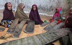 Pupils read and learn the Quran at an Islamic school, also known as a madrassa, at the Holy Quran school in the Hodan district of Somalia's capital Mogadishu.    Feisal Omar/Reuters