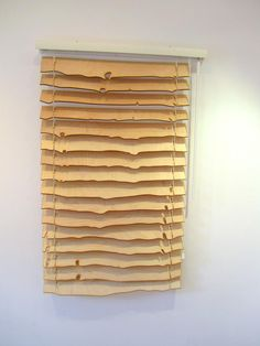 Venetian blinds by Alon Meron made of a sliced log. http://www.theshutterguy.net