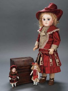 "Plump-Faced German All-Bisque Mignonette with Antique Costume  6"" (15 cm.) Bisque swivel head on kid-edged bisque torso,peg-jointed bisque arms and legs with painted high stockings and brown one-strap heeled shoes,tiny ankles,brown glass eyes,painted features,slightly-open mouth with tiny teeth,brunette mohair wig,wearing pretty antique silk dress,undergarments,felt pressed bonnet with silk edging. Condition: generally excellent. Marks: 121 (head). Comments: Germany,possibly Kling,circ"