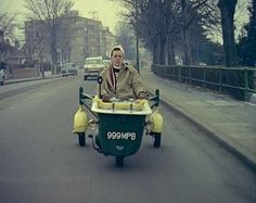 A student in Kingston, Surrey turns an old bath tub into a car by using a scooter motor. The nippy vehicle was used for shopping outings around town much to the delight of local children and spectators. This image is from 1960 but in these times of austerity and cutbacks we think this is an excellent idea.  If you're interested in making your own then have a search for the video 'Motorised Bath' later.