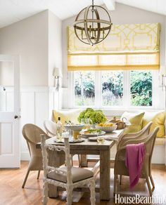 weathered table + window seat + roman shades & yellow hues