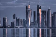 Photograph via Alexey Sergeev     Last month I saw a fascinating segment on Qatar by 60 minutes , a natural gas and oil-rich country with the highest GDP per capita in the world. I recalled numerous aerial shots of their cityscape displaying an eclectic collection