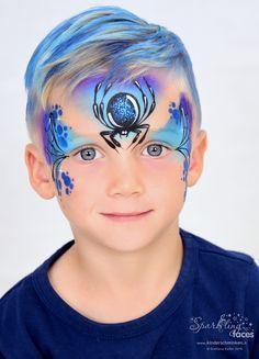www.kinderschminken.li, Spider face painting. Blue sparkle spider.