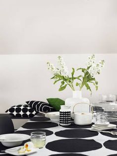 Marimekko Kivet White / Black Tablecloth Maija Isola's 1956 Kivet (Stones) pattern is set in it's classic black and white colorway atop a linen cloth. Perfect for use as a table linen but also suitable as a decorative bedding or wall tap. Black Tablecloth, Decor, Home Accessories, Table, Home, Interior, Marimekko, Table Cloth, Home Decor