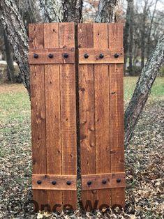 Stained cedar shutters exterior shutters Board and Batten Cedar Shutters, Rustic Shutters, Diy Shutters, Outdoor Shutters, Repurposed Shutters, Cedar Siding, Exterior Stain, Exterior Front Doors, Exterior Shutters