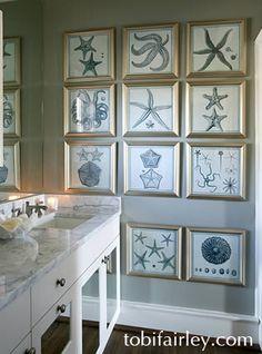 Sea prints in bathroom; design by Tobi Fairley