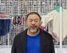 """Ai Weiwei, November 4, 2016, with his installation """"Laundromat,"""" 2016, at Jeffrey Deitch, New York."""