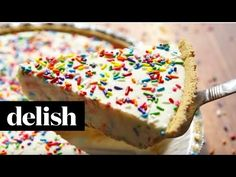 Frosted Animal Cracker Cheesecake Bars Funfetti cheesecake with a