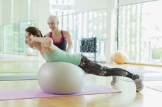 Woman doing back extension on exercise ball