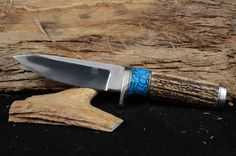"""Overall 9"""" with 4 3/4 blade.  Red Stag and man-made turquoise handle with mirror finish.  Made with 440C steel."""