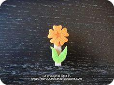 Mollette di legno con fiori in pannolenci