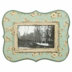 "Display cherished family memories with this vintage-inspired picture frame, showcasing a floral motif and green finish.  Product: Picture frameConstruction Material: Engineered woodColor: GreenFeatures: Holds one 4"" x 6"" photoDimensions: 9"" H x 11"" W x 2"" D"