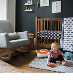 Love the combo of timber, dark wall, grey and blue and a shot of orange.