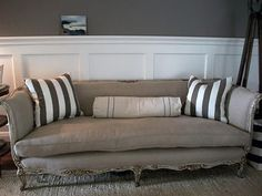 linen vintage couch with stripe pillows