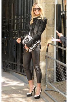 """If Elle Macpherson is self-conscious about her reported size 12 feet, she didn't show it when she hosted Saturday Night Live in 1996. During a sketch with Jim Breuer, the 6-foot-tall supermodel played an unappealing blind date who complains of """"a corn or a blister or something"""" and shoves her bare foot in his face. """"What, this here?"""" Breuer asks, trying to be a good sport with his beautiful companion. """"No, that's my wart."""" But he still has eyes of love. """"You know what,"""" he tells Macpherson…"""
