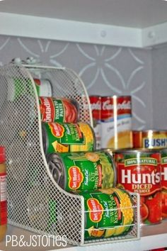Use a file for canned goods - $15 - this clever idea from PB&J Stories is similar to the dispenser-like soup displays you often see at the grocery store. See more cabinet organizing tips at HouseBeautiful.com.