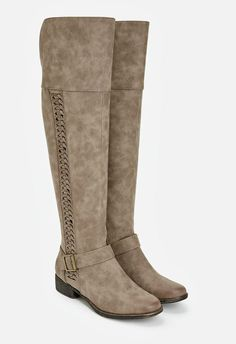A braided side detail makes these knee high boots your statement piece this…