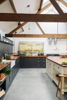 It's the mix of concrete floors, brick walls and soft tones in the wooden worktops and copper sink that make The Cattle Shed Shaker Kitchen such a clever combination. It is giving us some great kitchen inspiration for future projects. Devol Shaker Kitchen, Devol Kitchens, Home Kitchens, Modern Shaker Kitchen, Concrete Kitchen Floor, Kitchen Flooring, Wooden Worktop Kitchen, Concrete Floors In House, Brick Wall Kitchen