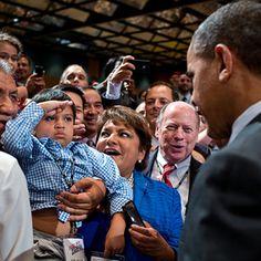 little man saluting President Obama. <3
