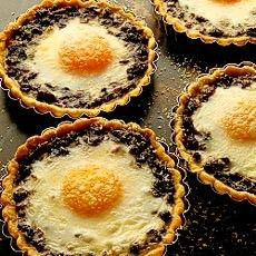 Baked Eggs in Wild Mushroom Tartlets Recipe from Chef Delia Smith.