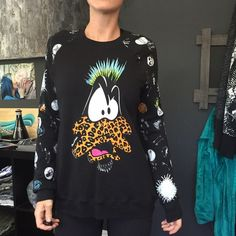 Daffy Duck sweater ✖️ nwot bought at kitson - designer : Lauren mosh   ✖️                                        all clothing is either NWT or has been washed + sanitized, then kept in a 🐾PET FREE and 💨SMOKE FREE environment .  too expensive , gonna break da bank ? Then add me to a 🛍 b u n d l e 🛍 or use the offer button    🗑 n o  l o w  b a l l i n g 🗑 REASONABLE offers accepted . Do NOT use offer button for requests like 40% below asking price .    🚫 🙅🏻 N O T R A D E S 🙅🏻 🚫…