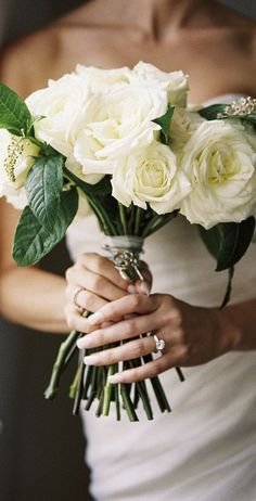 I don't care how cliché they are I will be having white roses as my bouquet.you know if I ever get married :/ Tulle Wedding, Wedding Bells, Wedding Bouquets, Wedding Dresses, Flower Bouquets, Bridesmaid Bouquet, White Rose Bouquet, White Roses, Cream Roses
