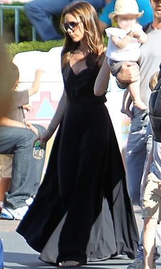 Victoria Beckham in a casual black maxi dress