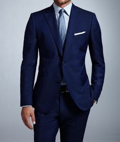 Sticking with one color can work. Navy blue suit looks nice with light blue tie and lighter blue shirt. The crisp look to the white pocket square is a nice touch. Classy, yes. If only the model had blue eyes to match his look. Light Blue Dress Shirt, Dress Shirt And Tie, Navy Dress Pants, Light Blue Dresses, Suit And Tie, Men Dress, Dress Ootd, Pant Shirt, Fashion Mode