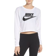 Women's Nike Sportswear Graphic Crop Tee ($34) ❤ liked on Polyvore featuring tops, t-shirts, longsleeve t shirts, long sleeve crop top, logo t shirts, cropped graphic tee and long sleeve graphic t shirts