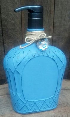 Painted up cycled, repurposed liquor bottle soap dispenser.