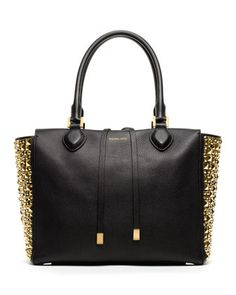 I've GOT to have this Michael Kors bag, but not for the price of $1595! That's just a tad bit too much money for my taste to spend on a handbag! But if I was rich or won the lottery, I'd have two... a black and a white one (if it came in white)...