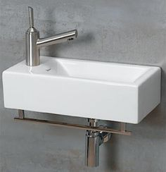 Whitehaus Wall-Mounted Basin - like the size & the built in towel bar (small powder room)