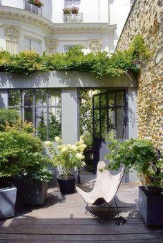 Ambiance farniente pour ce patio végétalisé