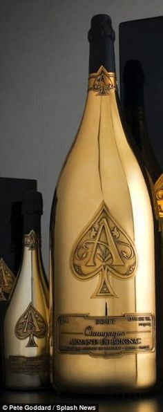 £125,000 on a single bottle of the world's most expensive champagne - Two waiters were needed to carry the 99lb bottle of champagne - so big it was the equivalent of 40 standard bottles of bubbly.
