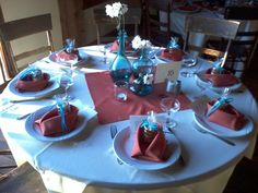 Round tables in the Loft at the Barn. Tri-size vase centerpieces