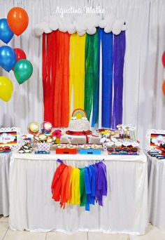 Dessert table at a rainbow birthday party! See more party ideas at CatchMyParty.com!