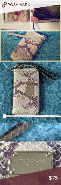 "🌸Michael Kors🌸 pearl grey leather phone case This gorgeous phone case doubles as a wallet, talk about ALL IN ONE! Ladies, we all need one, leave the purse at home! Grab your glamorous genuine leather phone case/wallet and off you go! Perfect for the busy woman, the tech savy girlie and even the minimalist! Never been used. 6.5"" length, 3.5"" height , 1"" thick. Will fit phones with length up to 5.5 inches, and about 1 inch thick. 3 business card slots and plenty of room for cash! Both new…"