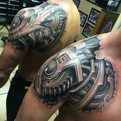 cool front and back bio mechanical tattoo