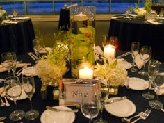 Table Centerpiece, Orchids in tall vase with water; Table flowers