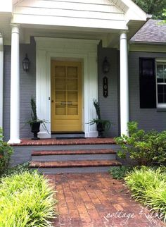 cottage and vine: Exterior Paint Before & After SW Summit Gray & Anjou Pear - Front door color Gray Front Door Colors, Yellow Front Doors, Exterior Stairs, Exterior Paint Colors For House, Paint Colors For Home, Exterior Doors, Paint Colours, Teal Door, Grey Brick Houses