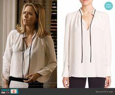 Elizabeth's white blouse with black tie neck on Madam Secretary.  Outfit Details: https://wornontv.net/60891/ #MadamSecretary