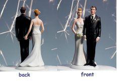 wedding cake topper, bride pinching groom