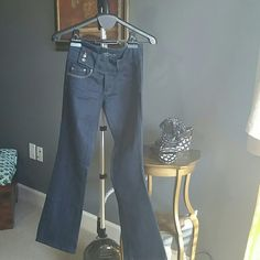 Miss Me Jeans Beautiful dark denim, zips with two buttons in front and additional 3 buttons on side. Inseam is 31 and bootcut. Pre loved and in mint condition. Miss Me Jeans