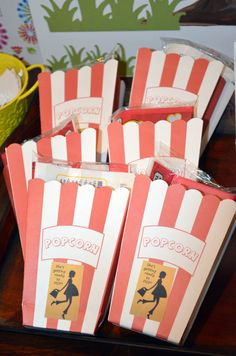 """Baby shower favors """"She's gonna pop"""" filled with a mini-bag of microwave kettle corn. Credit to Ginny and her crew!!"""