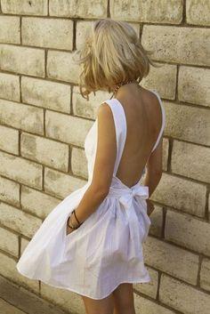 White open-back summer dress.