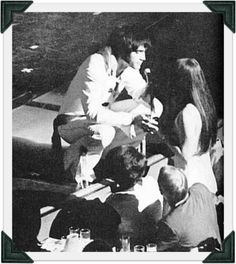 Elvis and Priscilla, Las Vegas 1970  - does anyone know if this is on film or just a photo I would loved to hear him call her to come up to the stage