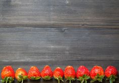 fresh strawberry on the wood background