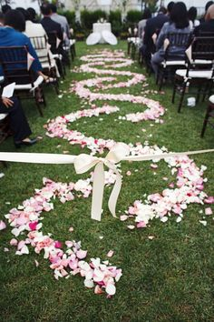 prettttty love the ribbon to keep guests from walking down the center so the bride  her father do the honors