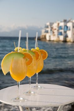 Tasty Cocktails decorated with Fruit Sticks and Local Summer Fruits. #capriceofmykonos #capricebar #littlevenicemykonos #capricebarmykonos #summercocktails #foodstyling #summerdrinks #visitmykonos #eventplanning #mykonos #greece Summer Cocktails, Cocktail Drinks, Alcoholic Drinks, Rice Bar, Fruit Sticks, Mykonos Greece, Summer Fruit, Fresh Fruit, Food Styling
